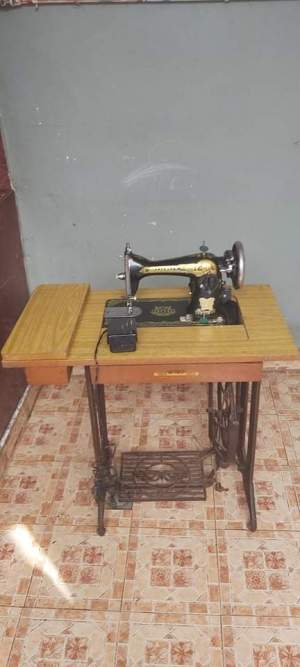 Singer Sewing Machine - Antiquities on Aster Vender