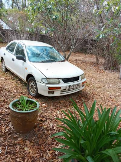 Mazda Car for sale - needs reparations - Family Cars on Aster Vender