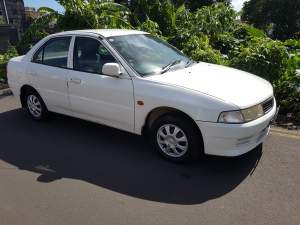 Mitsubishi Lancer JL00, manual - Family Cars on Aster Vender