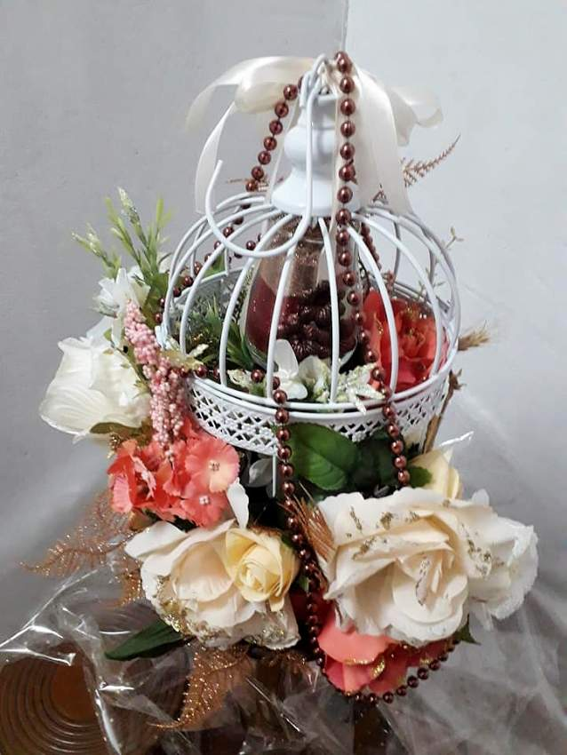 Deco birdcage with artificial flowers