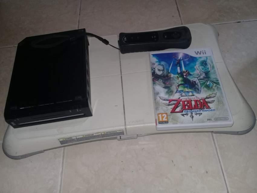 Nintendo Wii + Games + board