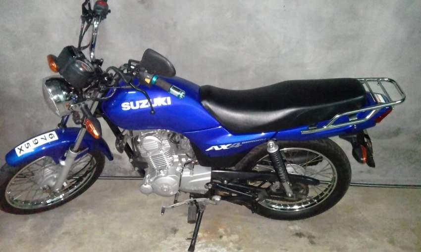 Suzuki Ax 4 blue motorcycle