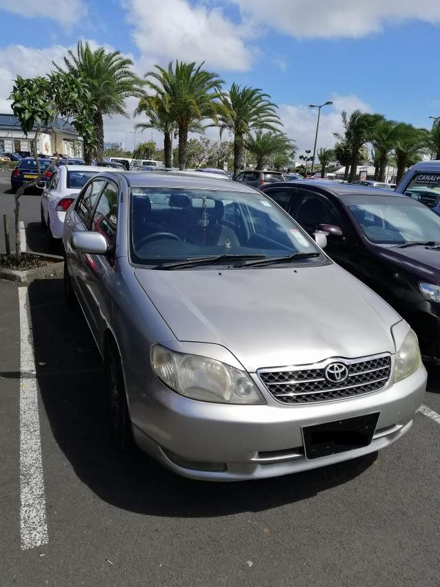 Toyota Corolla NZE Year 2002 / Silver color for sale