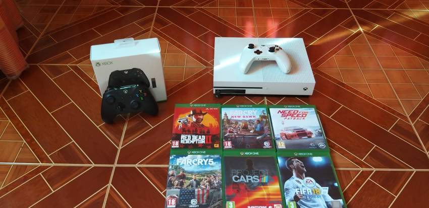 Xbox one 1 TB +6 GAMES+2 CONTROLLERS + 1 GAMING WHEEL